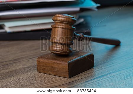 Wooden table with hammer, papers
