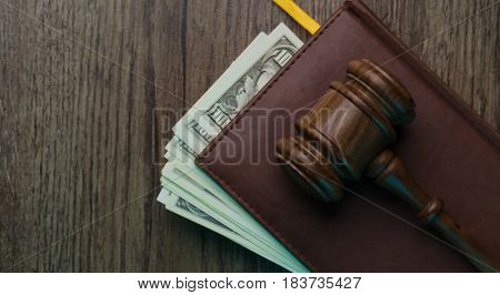 Hammer on folder with money