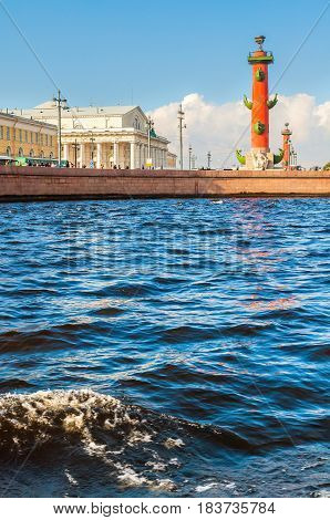 ST PETERSBURG, RUSSIA -OCTOBER 3,2016.St Petersburg architectural panorama - Neva river and St Petersburg landmarks of Vasilievsky island spit - rostral column and old stock exchange building in St Petersburg Russia