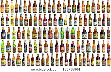 GRONINGEN, NETHERLANDS - APRIL 27, 2017: Collection of international beer bottles from all over the world isolated on a white background