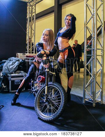 St. Petersburg Russia - 15 April, Models with a motorcycle,15 April, 2017. International Motor Show IMIS-2017 in Expoforurum. Models on motorcycles presented at the motor show.