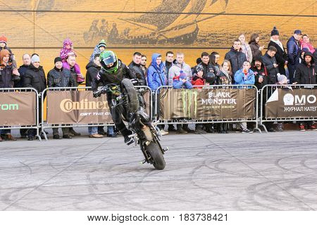 St. Petersburg Russia - 15 April, Moto freestyle on a bike,15 April, 2017. International Motor Show IMIS-2017 in Expoforurum. Sports motorcycle show of bikers on the open area.