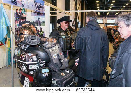 St. Petersburg Russia - 15 April, Visitors and participants of moto salon,15 April, 2017. International Motor Show IMIS-2017 in Expoforurum. Visitors and participants of the annual moto-salon in St. Petersburg.