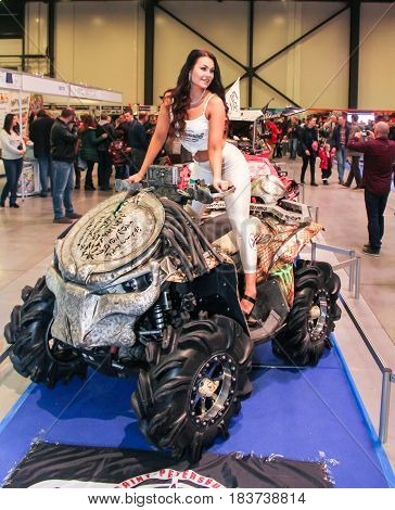 St. Petersburg Russia - 15 April, A fashion model at a motor show,15 April, 2017. International Motor Show IMIS-2017 in Expoforurum. Models on motorcycles presented at the motor show.