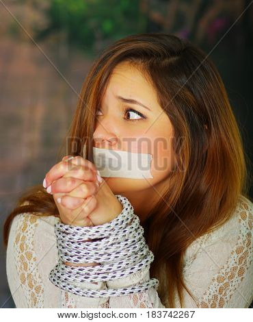 CLose up portrait of terrified young girl kidnapped and bonded
