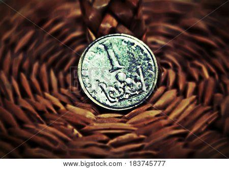 Shiny one czech crow czk coin on dark beige background