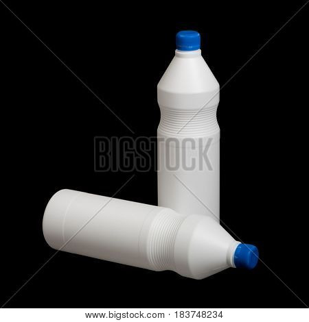 Two white plastic bottles on black background