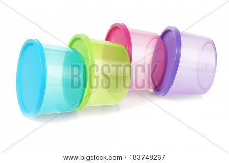 Colorful Round Plastic Containers Lying on White Background