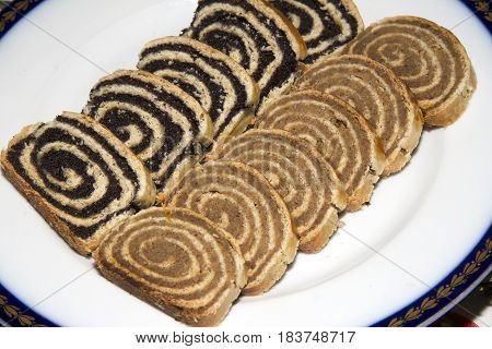 Homemade walnut and poppy seed rolls aka bejgli in Hungary. Traditional hungarian christmas or easter cake