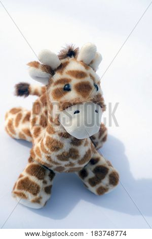 A soft and stuffed child's giraffe toy