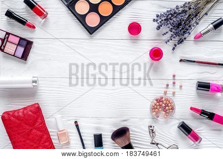 set of decorative cosmetics for women with lavender flowers on white table background top view mockup