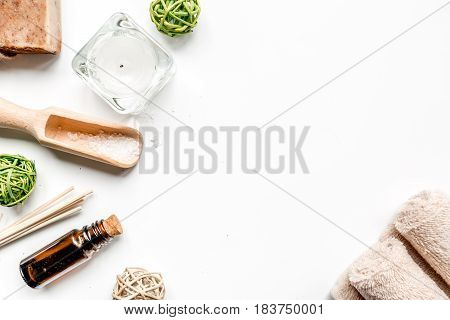 spa cosmetics with soap, salt, oil on white background top view space for text