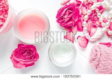 rose salt and cream for nail care in organic spa on white background top view