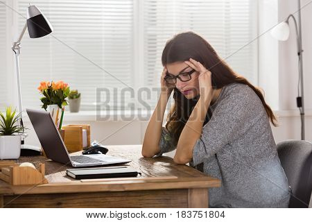 Sad Depressed Young Businesswoman Sitting In Office