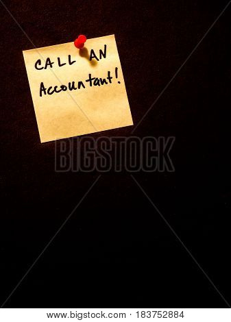 call an accountant post it note on black portrait orientation