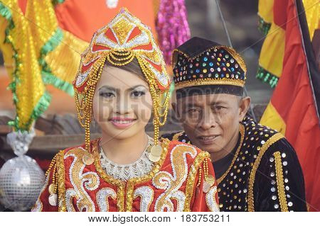 Semporna,Sabah-Apr 22,2017:Sea Bajau people generations photo in traditional costume during Regata Lepa Lepa in Semporna,Sabah.The Regatta Lepa in Semporna is one of the most colourful cultural events