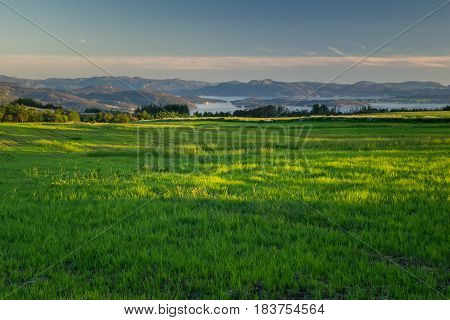 Fantastic view of Norwegian fields and other scenery at the background. Jorpeland Strand Rogaland Norway.