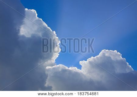 Big Billowing Clouds Drift Over A Bright Shinning Springtime Sun