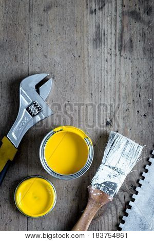 workplace of professional builder with instruments and paint set on wooden background top view mockup