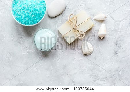 Home cosmetic with cream and sea salt on stone table background top view mock-up