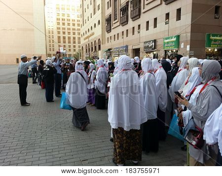 MADINAH, SAUDI ARABIA - AUGUST 19: Malaysian women pilgrims assembled in front of a hotel for a group visit to Prophet Mosque on August 19, 2015 in Medina, Saudi Arabia.