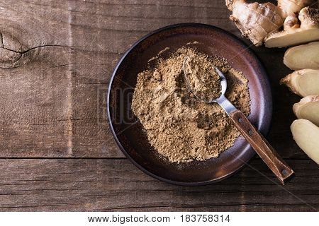 Ground Ginger Over Rustic Wooden Background
