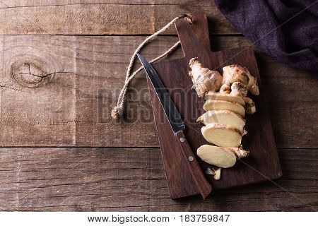 Top View Image Of Fresh Ginger Root On Cutting Board