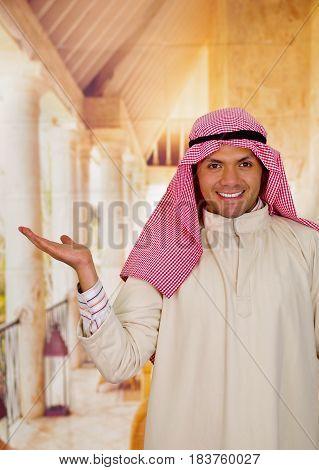 smiling cute young arabian man posing happy.