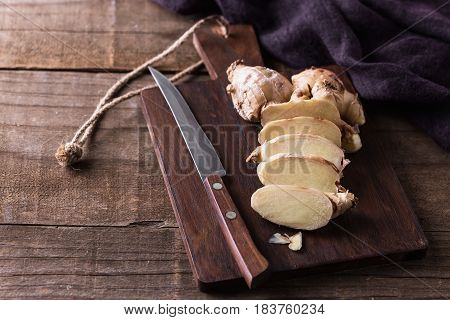 Fresh Ginger Root On Cutting Board