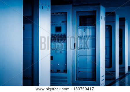 control room of a factory in blue tone.