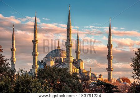Blue mosque with six minarets backlighted shot at sunset, Istanbul, Turkey.