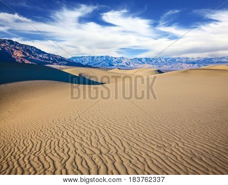 Small ripples on the sand dunes. Windy and hot morning in the desert.  Picturesque part of Death Valley, USA. Mesquite Flat Sand Dunes