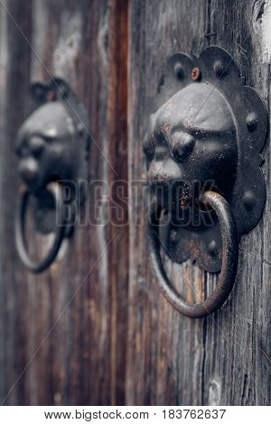 closeup of the antique oriental door knockerLishui citychina.