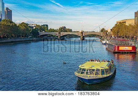 Melbourne Australia - April 4 2017: Cruise boat with tourists on Yarra river on sunny day