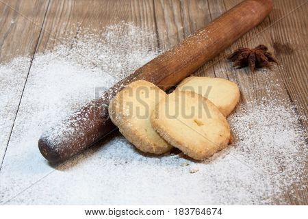 rolling pin flour and biscuits on the table