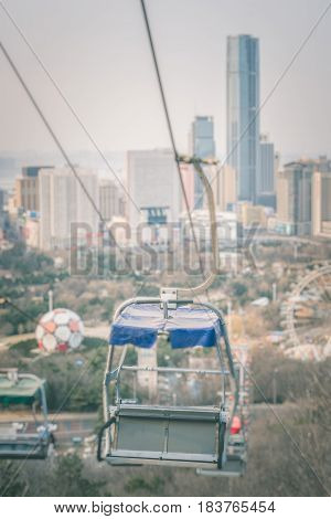 Overhead Cable Car wity cityscape in backgroundshot in ShanghaiChina.