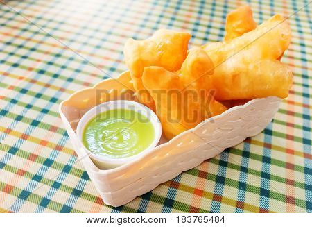 deep fried dough sticks with sweet green custard for breakfast
