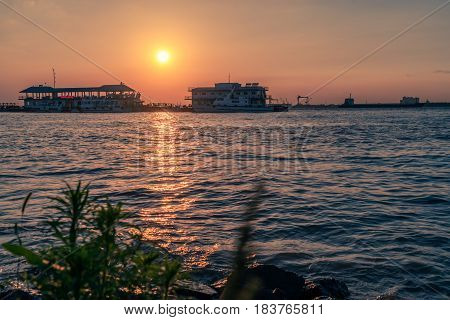 sunset view of cityscape along riverside located in China.
