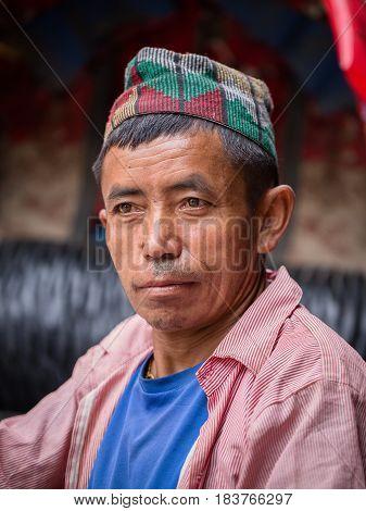 POKHARA NEPAL - SEPTEMBER 29 2016 : Portrait old men in traditional dress in street Pokhara Nepal
