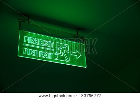 Green Light Exit Sign. Emergency Way Out Light Sing In The Building.