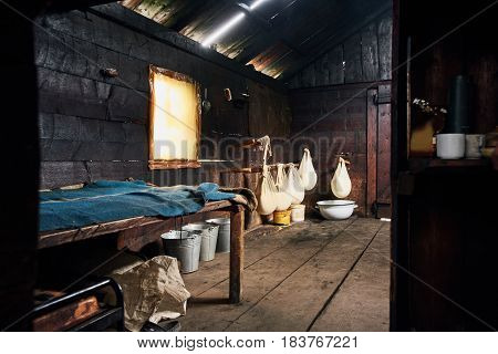 Interior of traditional wooden house of cheese makers in Ukraine