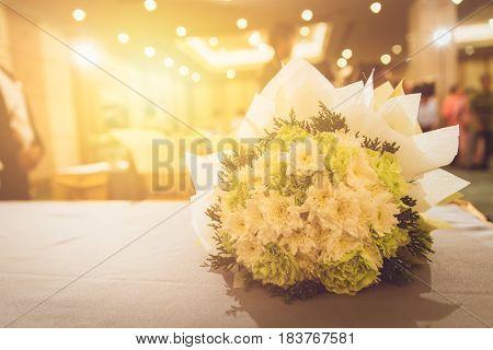 Bride Flower bouquet in hotel wedding party.