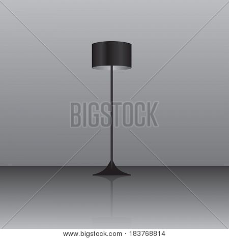 Floor lamp with a black lampshade on the floor with a reflective surface.