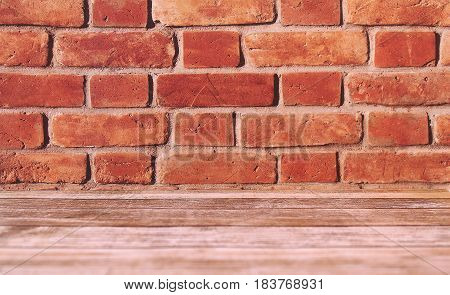 Horizontal brick background with wooden planks flooring.
