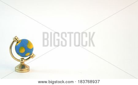 Miniature toy globe isolated on white background.