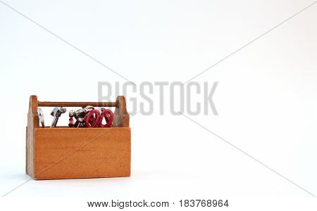 Miniature tool box isolated on white background.