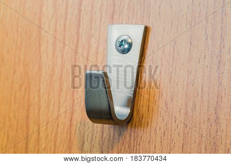 Metal Strong Hook. Steel Wall Hanger On Wood Background