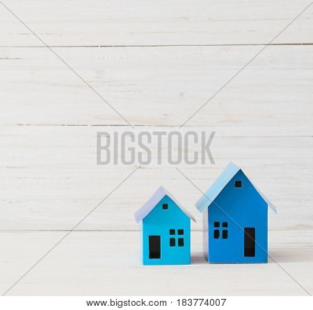 the blue paper houses on white background