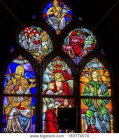 AMSTERDAM, NETHERLANDS - MARCH 30, 2017 Faith Love Hope Hell Heaven Jesus Christ Stained Glass Window De Krijtberg Church Amsterdam Holland Netherlands. Stained Glass in De Krijtberg Catholic Church in Amsterdam.