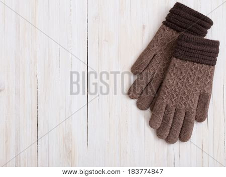 the gloves on a  white wooden background